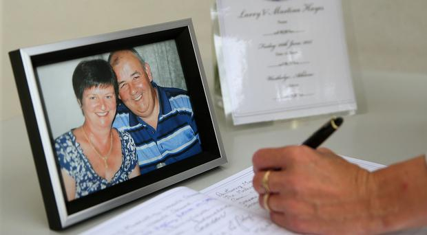 A book of condolence for husband and wife Laurence and Martina Hayes is signed in Athlone Civic Centre following their deaths in Tunisia