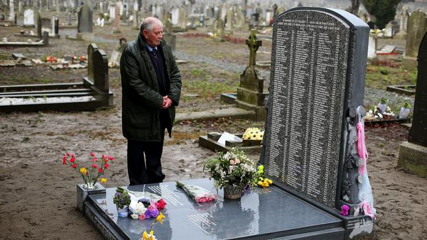 Chairman of the Bethany Survivors group Derek Leinster looks at the memorial at Mount Jerome Cemetery