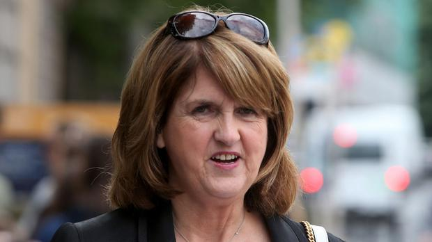 Joan Burton pelted with water balloons