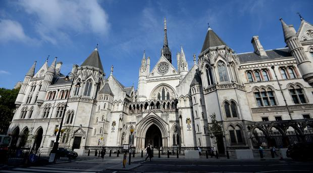 A blind athlete left paralysed when he fell from a bedroom window has won his High Court battle for damages