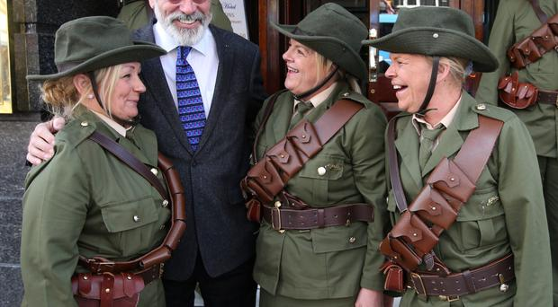 Sinn Fein president Gerry Adams with Sandra Browne, Judith Loftus and Denise Loftus from the Cabra Historial Society, dressed as Irish Volunteers, at the launch of the O'Donovan Rossa event