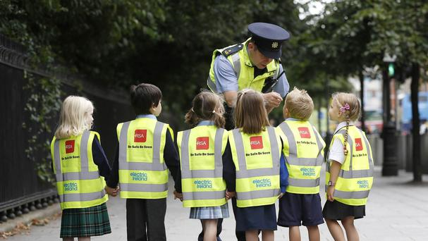 Children receive their high-visibility vests from the Road Safety Authority in Dublin.