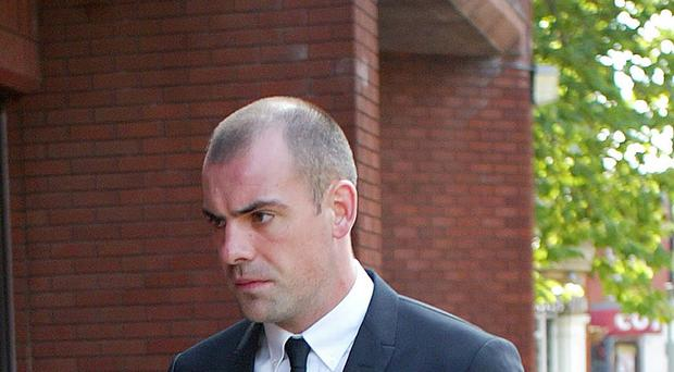 Footballer Darron Gibson arrives at Trafford Magistrates' Court in Sale, Cheshire, where he appeared accused of crashing his sports car into a cyclist while drink-driving