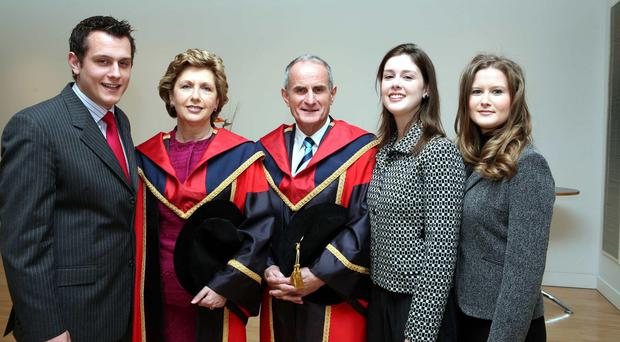 Mary McAleese and her husband Martin McAleese being conferred with honorary degrees by Dublin City University, with their children Justin, Sarah and Emma