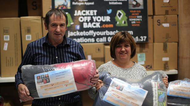 Kevin and Sue Kelly from the Jacket Off Your Back campaign at the charity's warehouse in Carlow