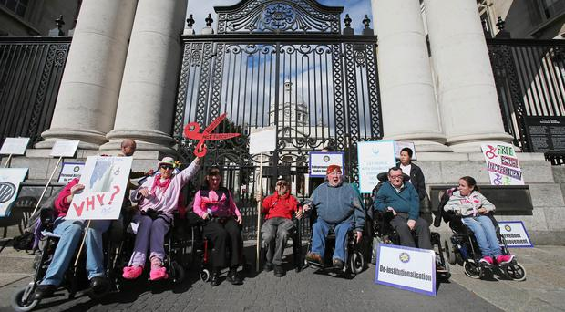 A group of disabled people and campaigners take part in a three-day sit-out at the gates of Government Buildings in Dublin
