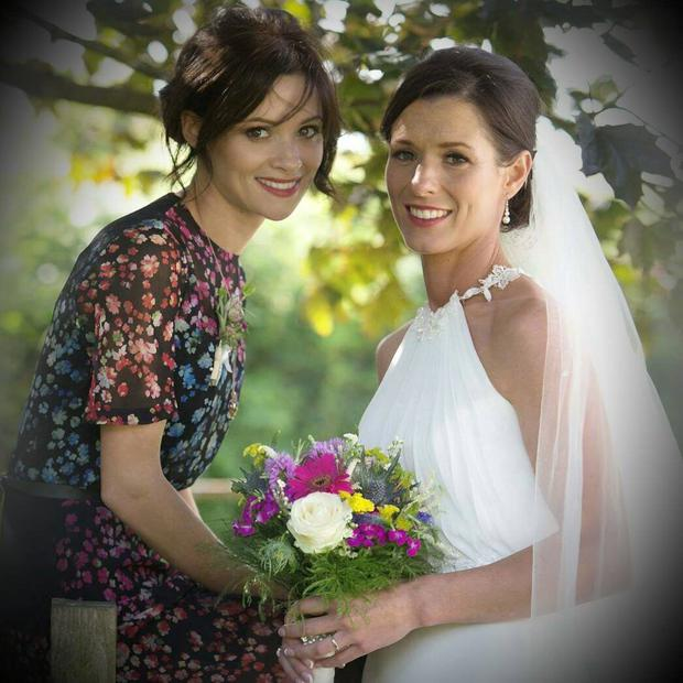 Jim Carrey's ex-girlfriend Cathriona White (left) and her sister Lisa posing for pictures during Lisa's wedding day on August 8, 2014