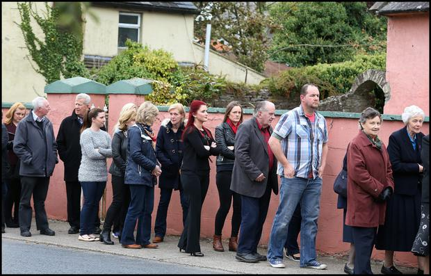 Crowds gather at White Funeral Home in Cappawhite, yesterday