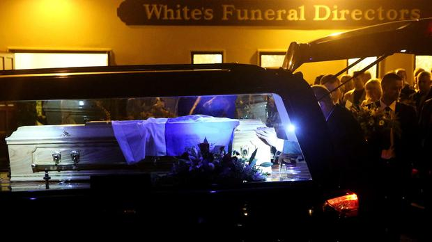 The coffin of Cathriona White, the ex-girlfriend of Jim Carrey, is placed into a hearse.