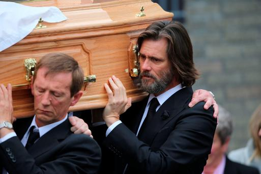 Jim Carrey carries the coffin of ex-girlfriend Cathriona White to Our Lady of Fatima Church, in her home village of Cappawhite, Co Tipperary ahead of her funeral