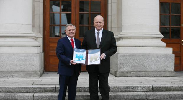 Minister for Public Expenditure and Reform Brendan Howlin, left, and Minister for Finance Michael Noonan delivered the 2015 Budget at Government Buildings