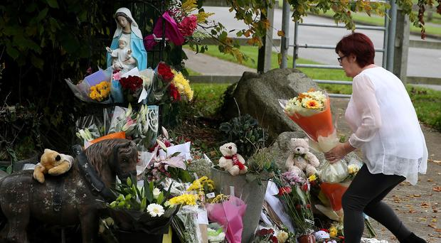 Flowers were laid outside a halting site for travellers in Carrickmines where 10 people were killed in a fire