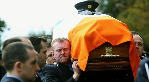 The coffin of Garda Tony Golden is carried into St Oliver Plunkett Church, in Blackrock, Co. Louth for his state funeral