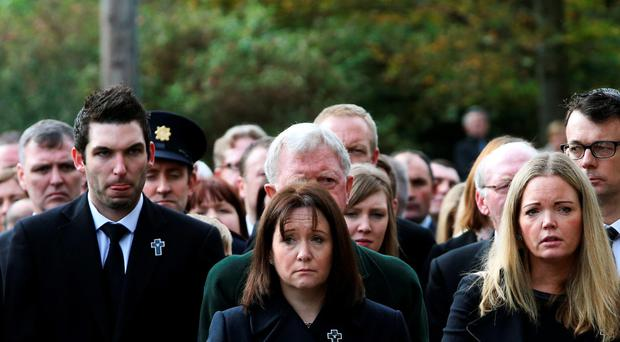 Nicola Golden (centre), wife of murdered Garda Tony Golden, with family and friends at St Oliver Plunkett Church in Blackrock, Co Louth, for his State funeral yesterday