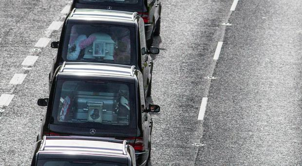 The remains of Willy Lynch, his partner Tara Gilbert, and children Jodie (9) and Kelsey (4), and Willy's brother Jimmy after their funeral mass in Bray, Co Wicklow