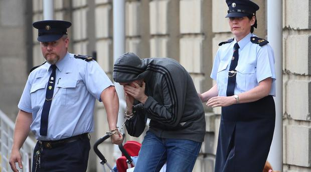 Eric Eoin Marques being led away from the High Court at an earlier hearing