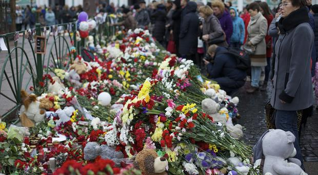 Floral tributes in memory of the plane crash victims at Dvortsovaya Square in St.Petersburg, Russia (AP)