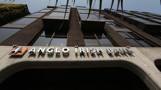 Irish criminal investigators accuse David Drumm of conspiring to conceal massive losses at Anglo Irish Bank from shareholders