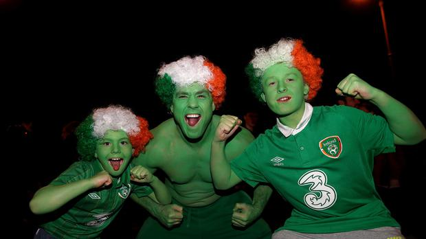 Irish fans are celebrating qualification for next summer's finals in France
