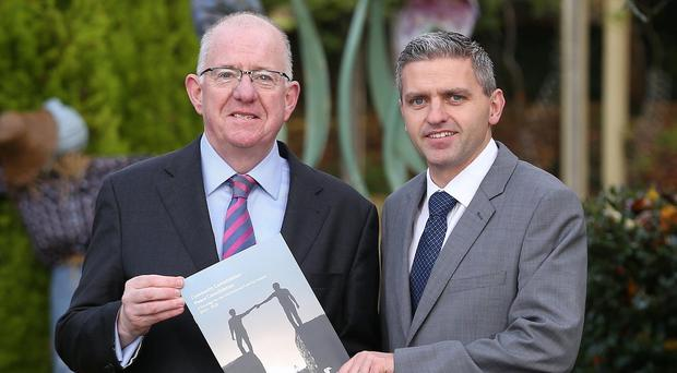 Adrian Johnston, chairman of the International Fund for Ireland, right, with Irish Minister for Foreign Affairs Charlie Flanagan