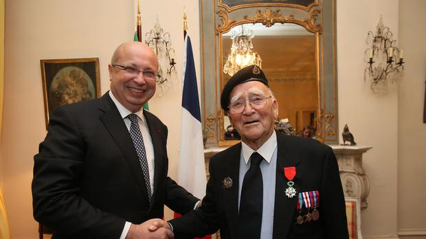 War veteran Henry John Alfred Place is bestowed with France's highest honour by the French Ambassador to Ireland Jean-Pierre Thebaul in Dublin
