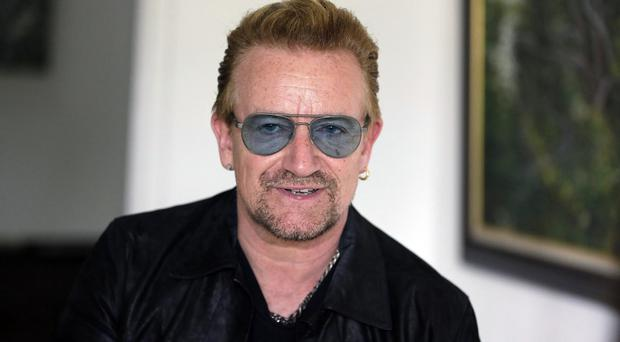 Bono has said the character of Paris will not change despite the terror attacks last month (AP)
