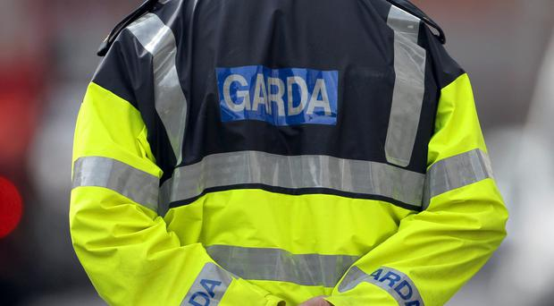 Gardai are investigating after a gunman robbed up to 40 born-again Christians in Dublin