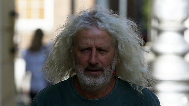Independent TD Mick Wallace was found guilty of entering a restricted zone at Shannon Airport