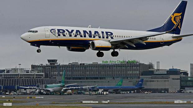 A Ryanair plane lands at Dublin Airport