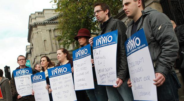 The INMO had threatened strike action in December in response to
