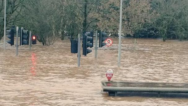A bus shelter nearly submerged in floodwater in Mallow, County Cork (taken with permission of David Morrisey from Twitter feed of @DavidMorrissey5)