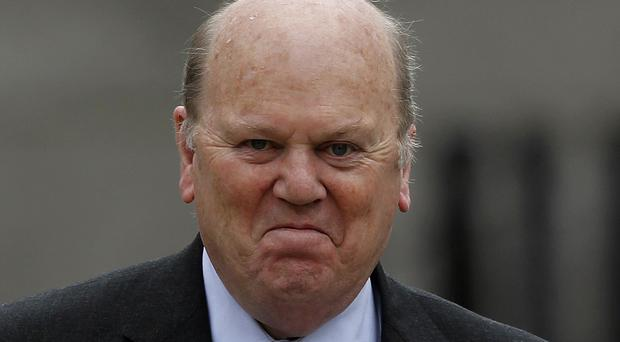 Finance Minister Michael Noonan made his first public appearance since undergoing hospital treatment over Christmas