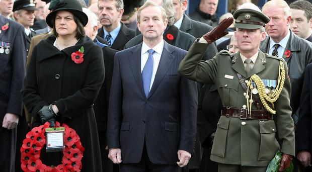Taoiseach Enda Kenny with Arlene Foster attending a commemoration ceremony at Enniskillen cenotaph