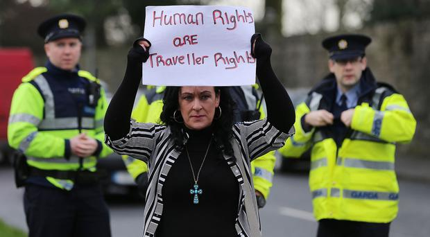 Travellers attend a protest at Louth County Council offices after residents were evicted from a halting site in Dundalk