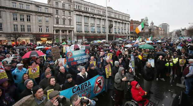 Protesters from the Right2Water movement opposed to water taxes and austerity gather in Dublin