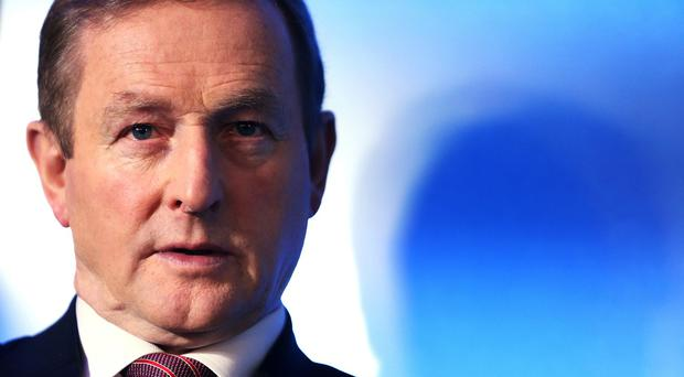 Enda Kenny has vowed to finish the job of securing Ireland's economic revival