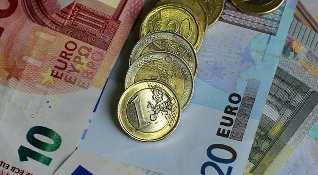 Eircode cost 20 million euro more than originally forecast, a spending watchdog has been told