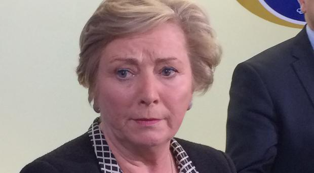 Frances Fitzgerald said an extra 1,800 gardai will be recruited by a re-elected administration to stand up to ruthless gangs