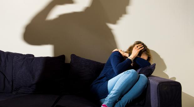 Picture posed by models: Politicians were told to implement measures to help victims of domestic violence