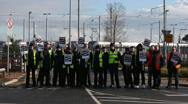 Luas drivers on a picket line in Sandyford in Dublin