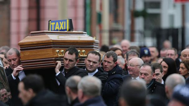 The coffin is carried into Our Lady of Lourdes Church in Dublin for the funeral of Eddie Hutch Snr