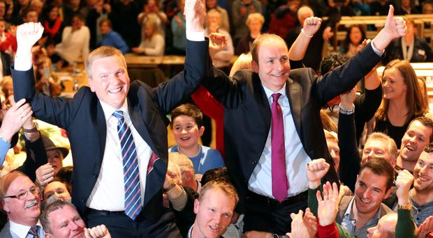 Fianna Fail leader Micheal Martin (right) and Michael McGrath (left) celebrate at the general election 2016 count at the City Hall in Cork