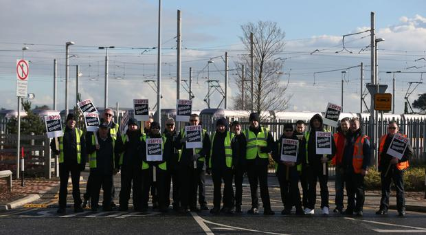 Luas drivers during a previously strike in Sandyford in Dublin
