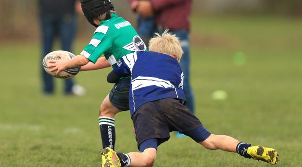 Doctors warned of a high risk of serious injury among under-18s and said schools should move to touch rugby instead.
