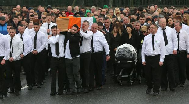 The coffin of dissident republican Vincent Ryan is carried into The Church of the Holy Trinity in Donaghmede, Dublin
