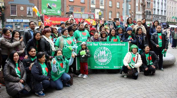 Undocumented migrants gather in Dame Street in Dublin