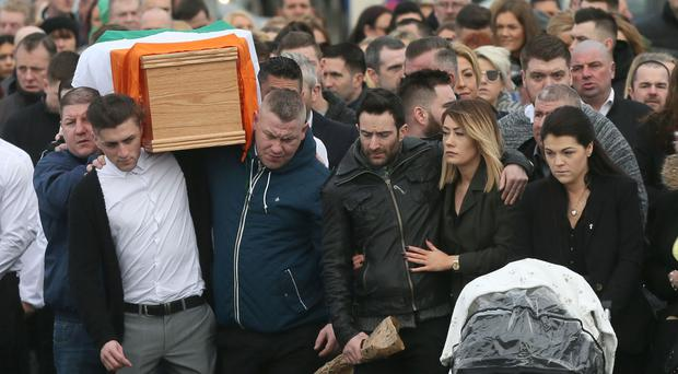 The coffin of dissident republican Vincent Ryan is carried into The Church of the Holy Trinity in Donaghmede, Dublin, for his funeral Mass