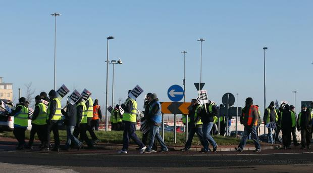 Luas workers man a picket line during a strike at the Transdev depot at the Red Cow roundabout in Dublin