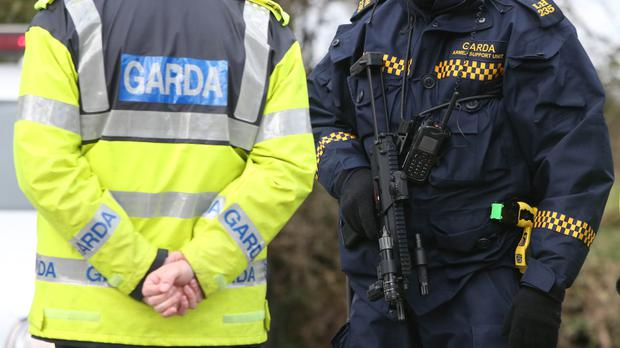 Gardai are quizzing two men about a suspected New IRA bomb plot after explosives were found in a car in Dublin' rush hour
