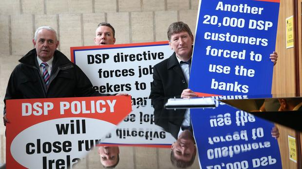 Members from the Irish Postmasters' Union hold a protest at the caretaker Social Protection Minister Joan Burton's office in Store Street in Dublin